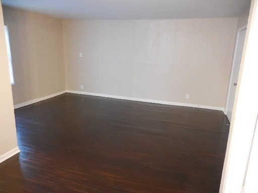 Spacious Downstairs 11 with Hardwoods in Small Complex